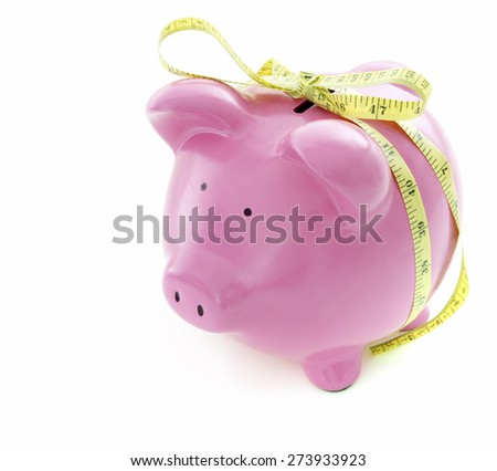 Piggy Bank on White Background with tape measure - stock photo