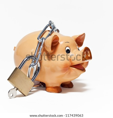Piggy bank secured with padlock on white background. - stock photo