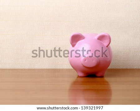 Piggy bank style money box isolated on a white background. - stock photo