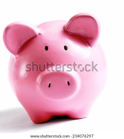 Piggy bank style money box isolated on a white background. - stock photo