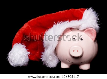 Piggy bank wearing christmas santas hat cutout - stock photo