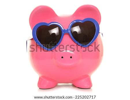 piggy bank wearing heart sunglasses cutout - stock photo