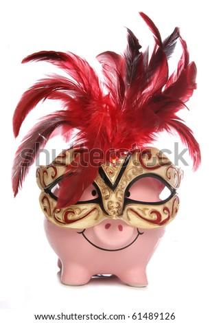 Piggy bank wearing party masquerade mask studio cutout - stock photo