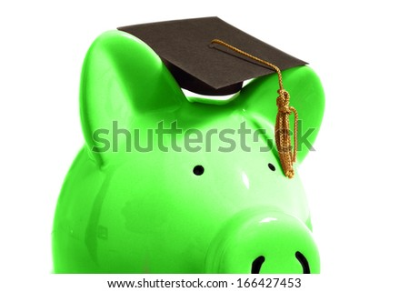 Piggy bank with a graduation cap, on white                                - stock photo