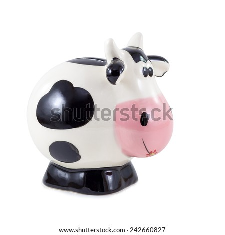 Piggy bank with black and white cow spots - stock photo