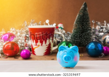 piggy bank with Christmas decoration background., abstract background to time to start to saving or solution for keep money for celebration. - stock photo