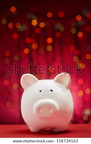 Piggy bank with Christmas lights background - stock photo