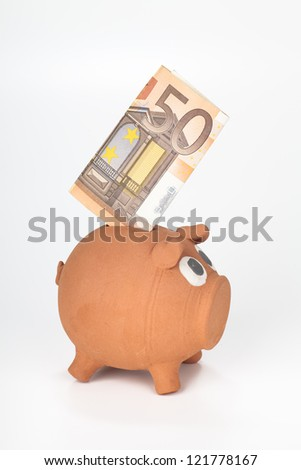 Piggy bank with 50 euro banknote - stock photo