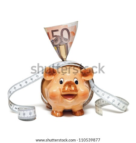 Piggy Bank with 50 Euro note and tape measure - stock photo