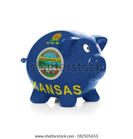 Piggy bank with flag coating over it isolated on white - State of Kansas - stock photo