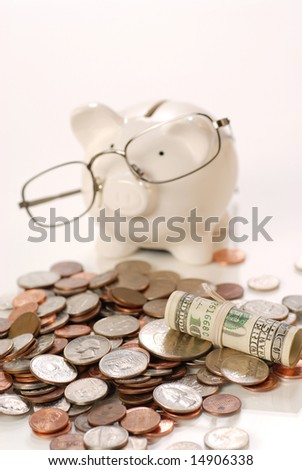 piggy bank with glass and US coins - stock photo