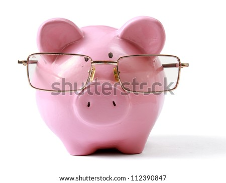 piggy bank with glasses in isolated white background - stock photo