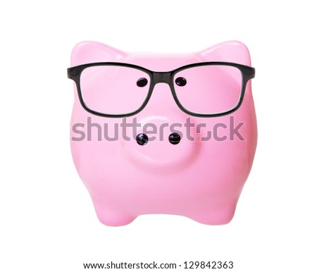 Piggy bank with glasses isolated on a white studio background - stock photo