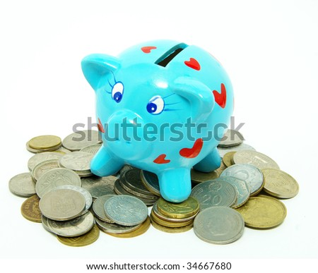 Piggy bank with golden coins - stock photo