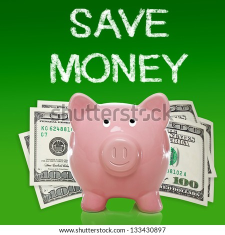 Piggy bank with hundred dollar bills on green background - save money - stock photo