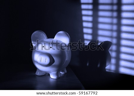 Piggy Bank with light from blinds in background - stock photo