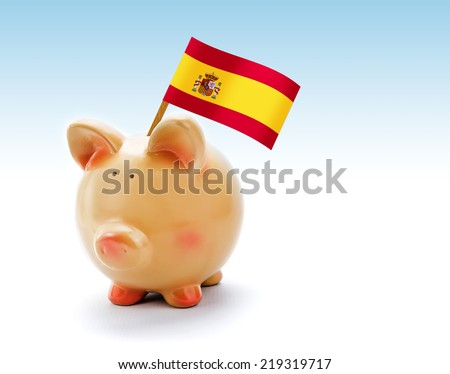 Piggy bank with national flag of Spain - stock photo