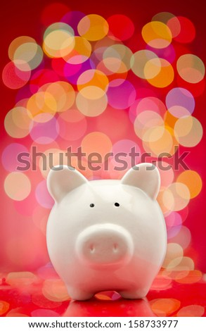 Piggy bank with party lights background - stock photo