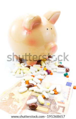 Piggy bank with pile of pills and banknotes isolated  - stock photo