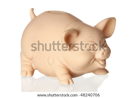 Piggy bank with reflection on the floor isolated on white background - stock photo