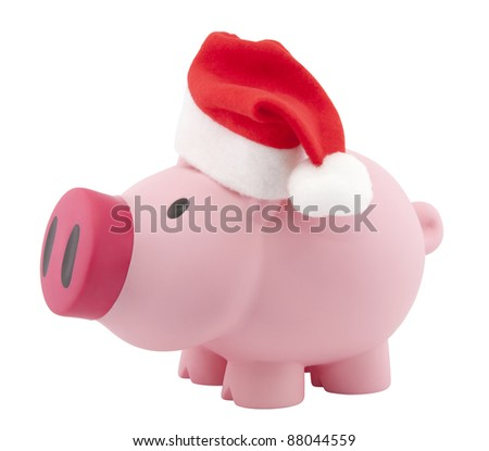 Piggy bank with Santa Claus hat. Clipping path included. - stock photo
