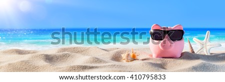 Piggy Bank With Sunglasses On The Beach Holiday  - stock photo