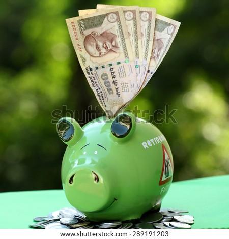 Piggy bank with sunset light - money concept - stock photo