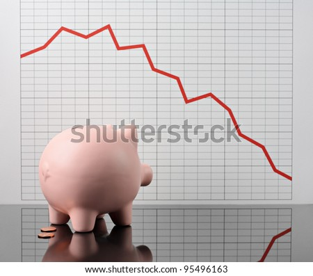 piggy bank worrying over stock market crash - stock photo