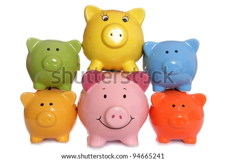 Piggy banks stacked on a white background - stock photo