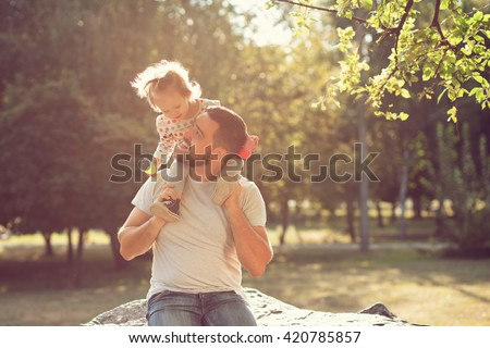 Piggyback of baby and dad - stock photo