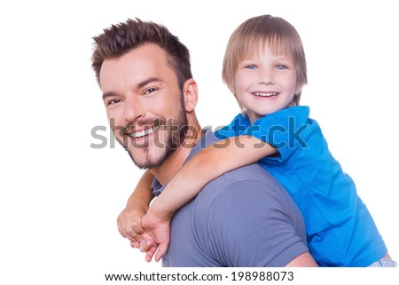 Piggyback ride. Side view of happy father carrying his son on back and smiling while both standing isolated on white - stock photo