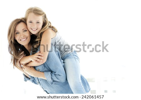 Piggyback ride with mum - stock photo