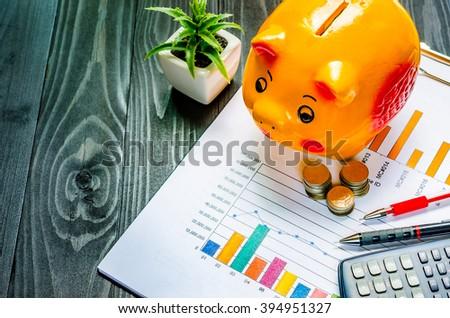 Piggybank, coin, calculator,graph paper, pencil, Business concept - stock photo