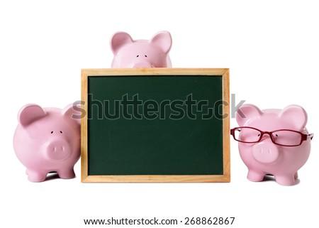 Piggybank saving plan education concept, chalkboard, copy space - stock photo