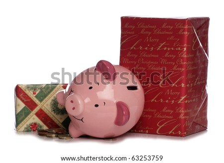 Piggybank with christmas presents studio cutout - stock photo