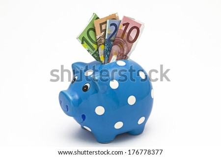 Piggybank with various banknotes - stock photo