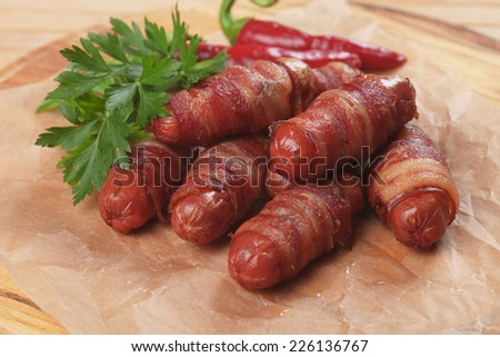 Pigs in blanket, mini sausage and bacon rolls - stock photo