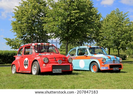 PIIKKIO, FINLAND - JULY 19, 2014: Two Fiat Abarth racing car in a park. Abarth began his well-known association with Fiat in 1952. - stock photo