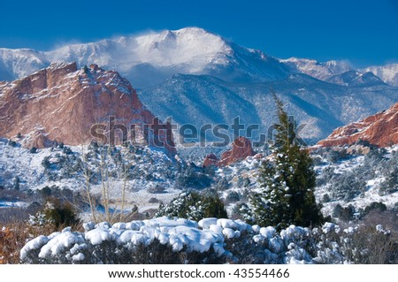 Pikes Peak Soaring over the Garden of the Gods near Colorado Springs, Colorado in Winter after a fresh snowfall - stock photo