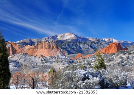Pikes Peak Soaring over the Garden of the Gods near Colorado Springs, Colorado in Winter with Majestic deep blue sky - stock photo