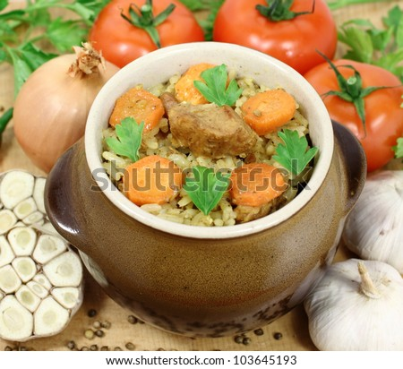 pilaf Central Asia, South Asia, the Caucasus and the Middle Eastern dish consisting of stewed meat and rice with carrots - stock photo