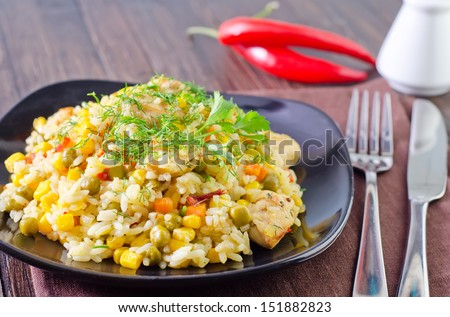 Pilaf on black plate - stock photo
