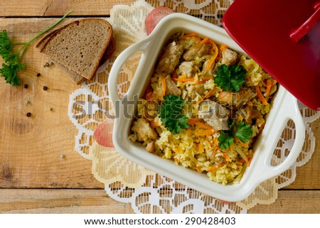 Pilaf with meat in pot - stock photo