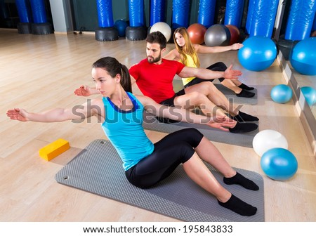 Pilates people group exercise man and women at fitness gym - stock photo