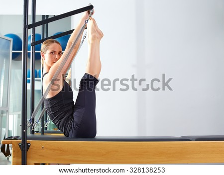 Pilates woman in reformer monki exercise at gym indoor - stock photo