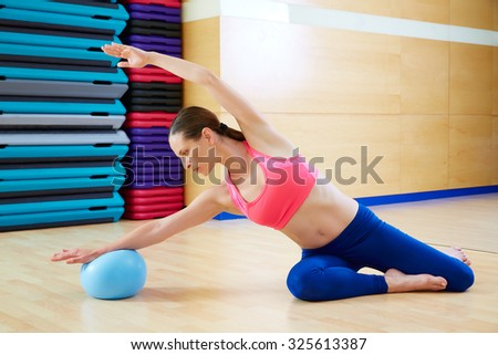 Pilates woman mermaid stability ball exercise workout at gym indoor - stock photo