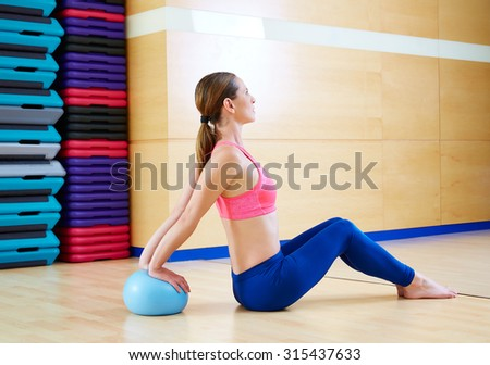 Pilates woman stability ball exercise workout at gym indoor - stock photo