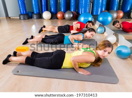 Pilates Yoga training exercise in fitness gym people group - stock photo