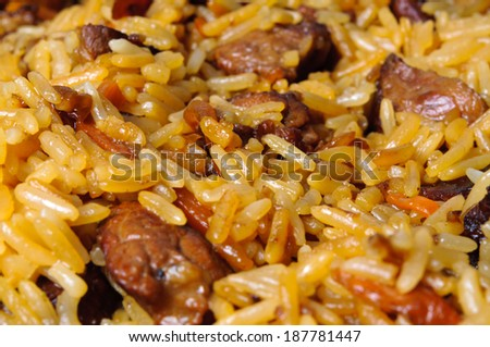 Pilau (pilaw, plov) - a rice and meat meal macro - stock photo