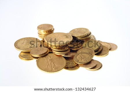 Pile Gold coins american and french on white background - stock photo